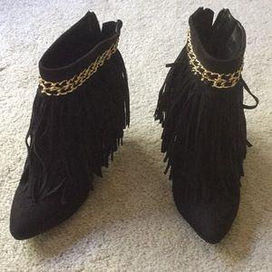 Black fringe high heel boot.